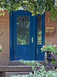 Blue entry door with glass insert